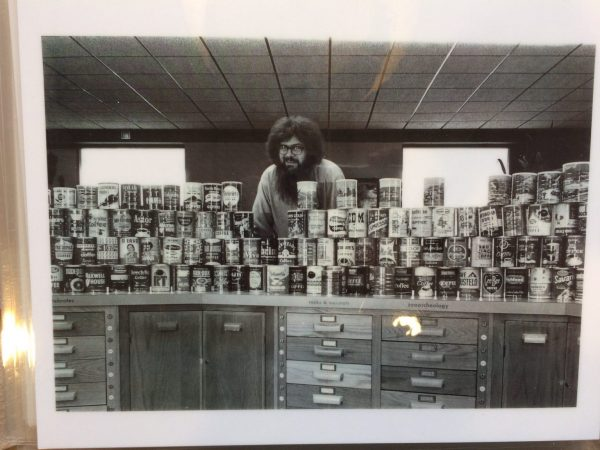 Thomas Olmstead with his coffee can collection