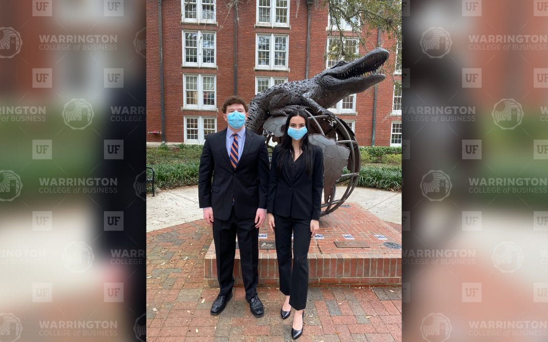 Jacob Orlick and Savannah LoPiccolo stand in front of the Gator Ubiquity Statue