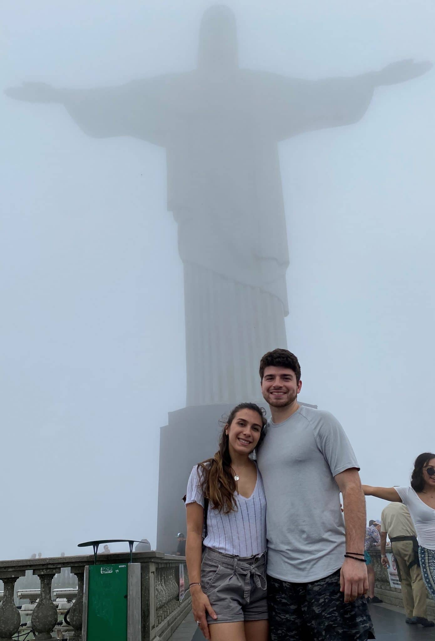 Rocky Cartaya poses in front of the Christ the Redeemer statue in Brazil