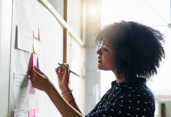 A young female designer working in her office