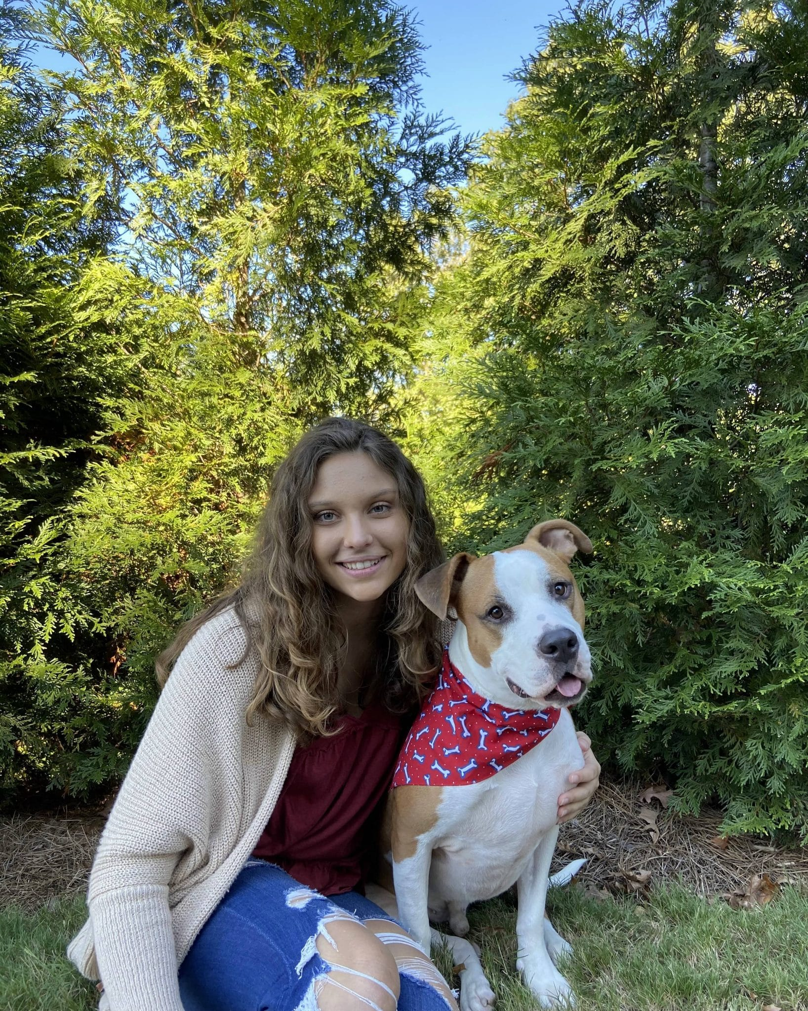 Ashley Arndt poses for a photo with her pit bull, Jude.