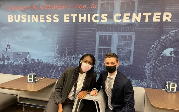Kitan Adeniji and Zach Kashman pose for a photo in the Poe Business Ethics Center