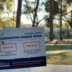 Yard sign advertising Warrington Career Week with its dates and how to access the event online with a background of the Warrington campus.