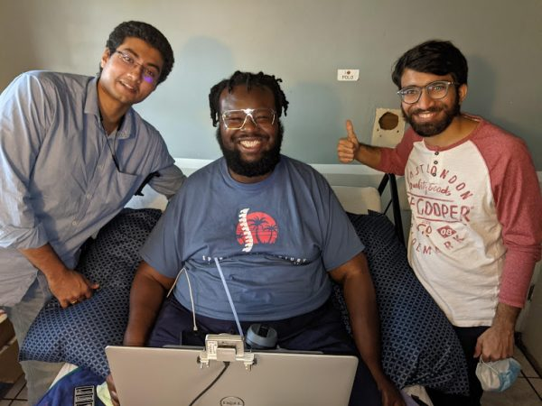 BrainForce employees help the disabled use phones and computers