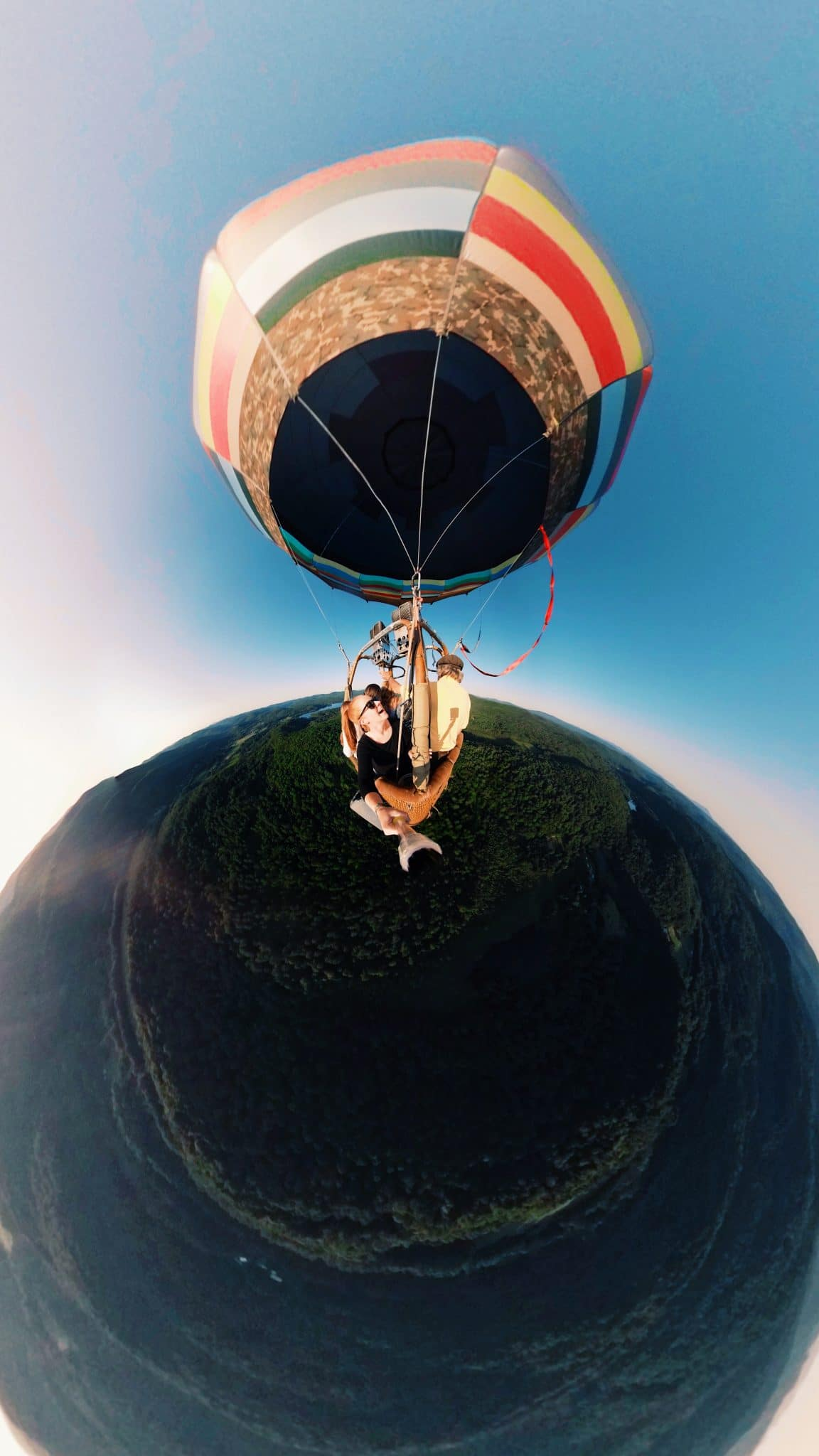 A fish eye view of a hot air balloon with Stevie Faulk in the basket