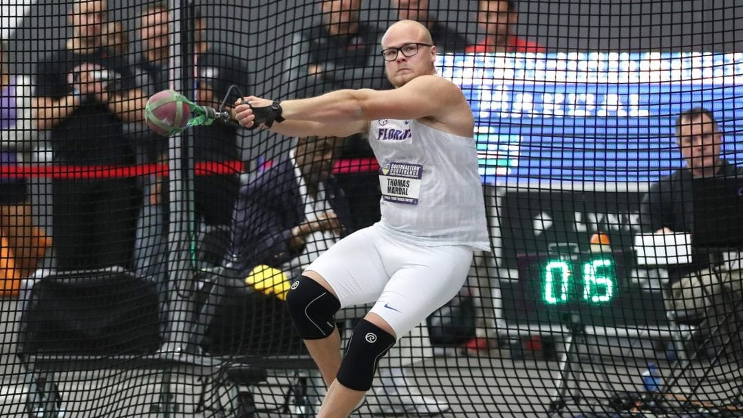 Thomas Mardal winds up to make his hammer throw during a track and field event.