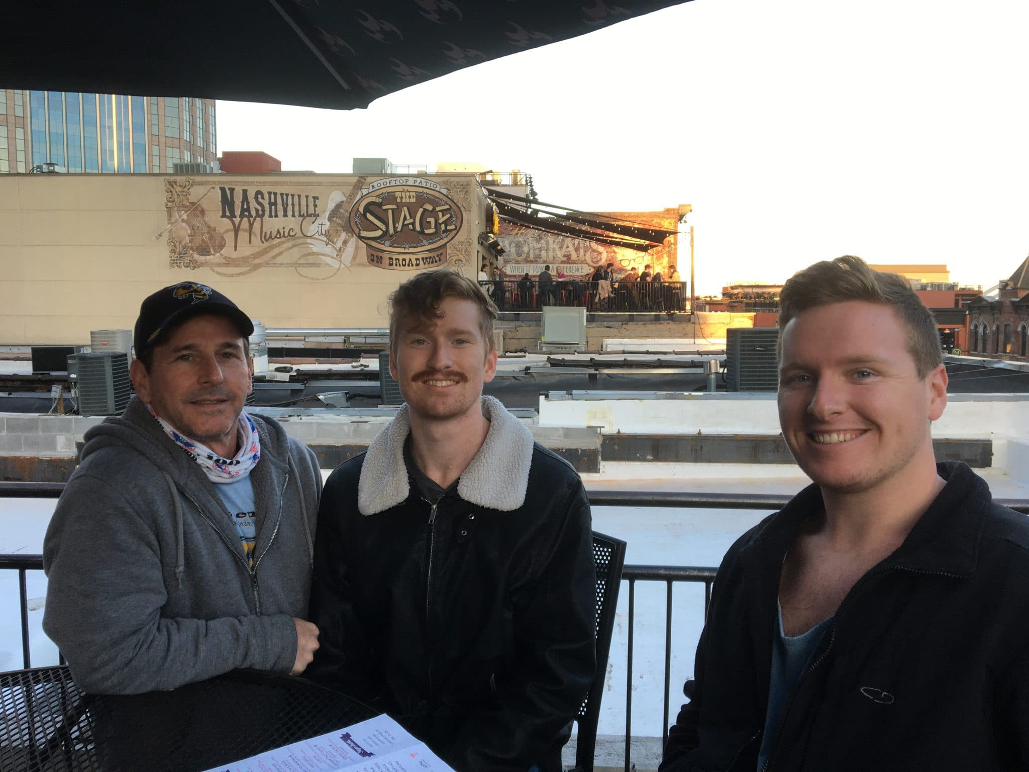 Jacob Schuster poses for a photo with two other men in Nashville.