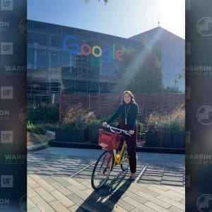 Nelly Wilson poses for a photo on a bike in front of Google's office in Austin.