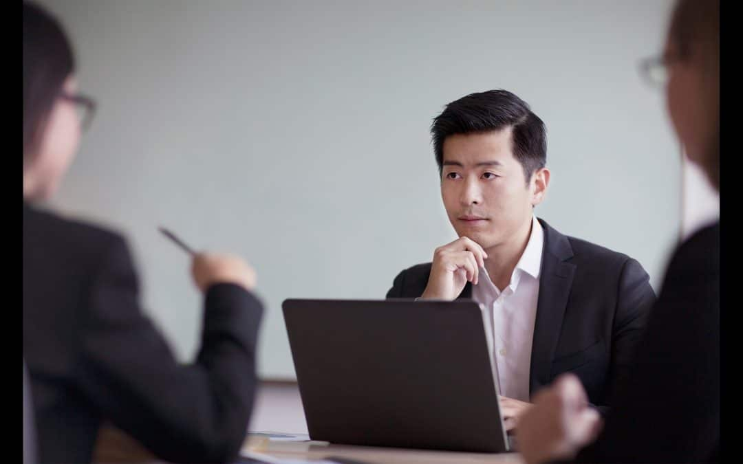 Man in board room considering an MBA