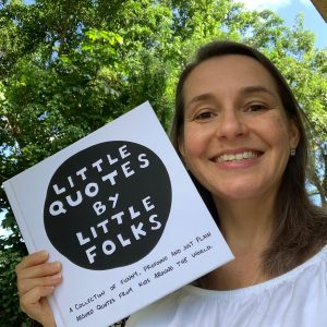 Rebecca Carter holds a copy of her book, Little Quotes by Little Folks.