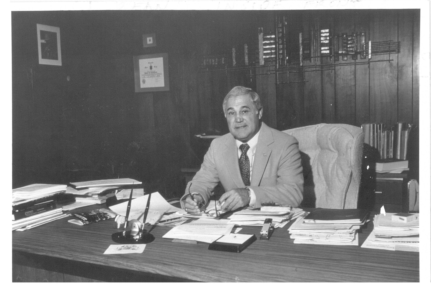 Robert Lanzillotti sits at his desk while serving as Dean of the Warrington College of Business.