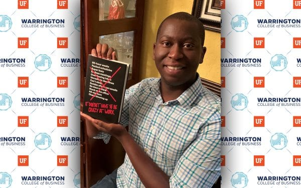 Warrington alumnus Brandon Harris holds a copy of his book recommendation, It Doesn't Have to be Crazy to Work.