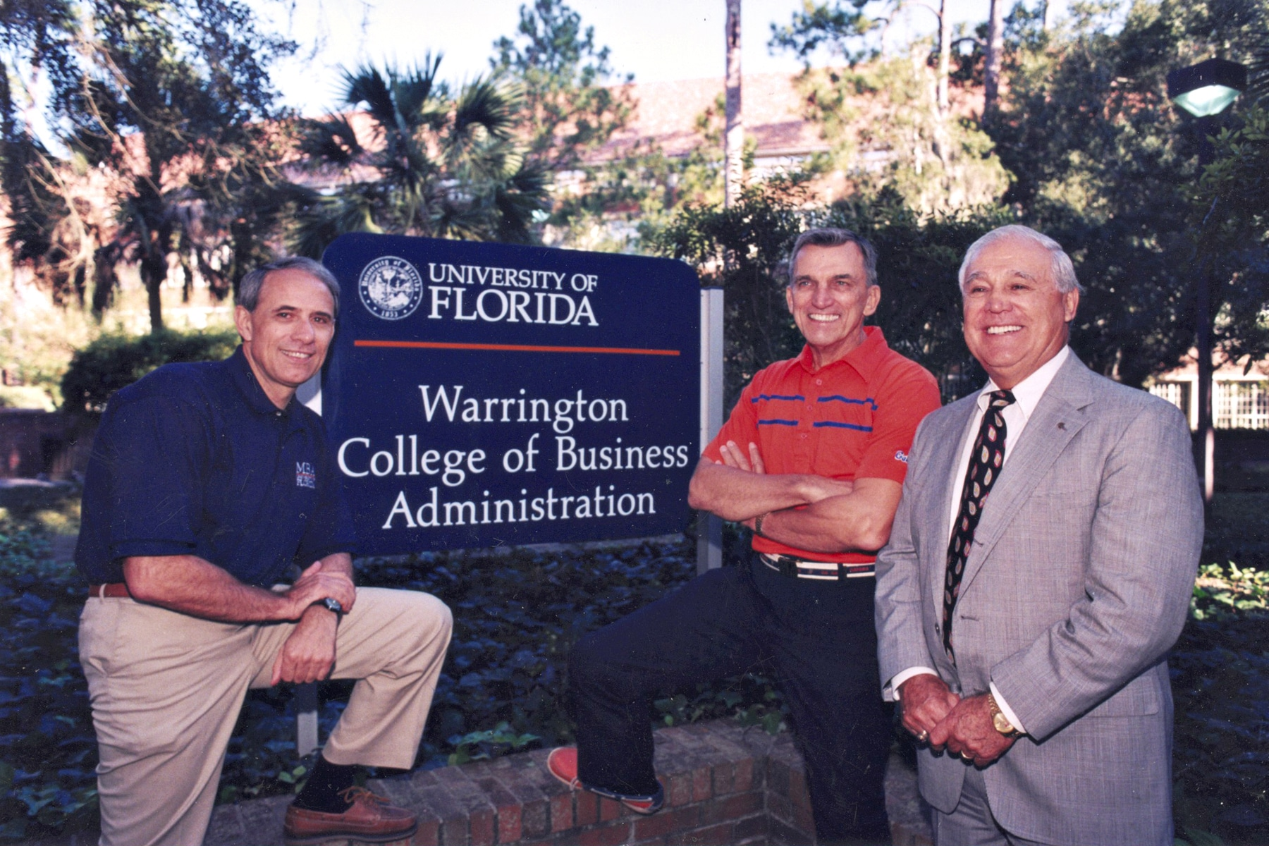 John Kraft, Al Warrington and Robert Lanzillotti pose for a photo in front of the Warrington College of Business sign.