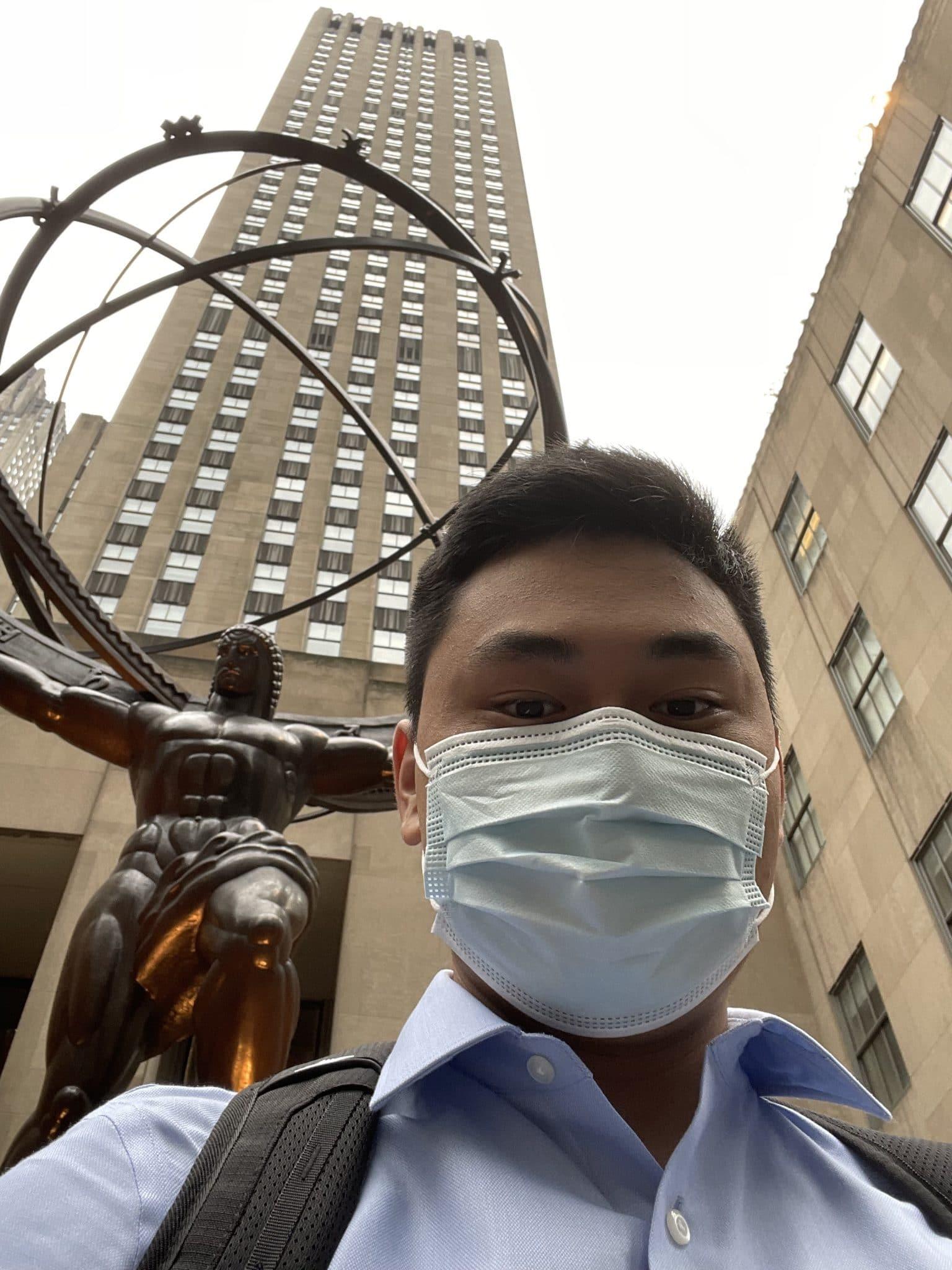 Kyle Nguyen takes a selfie in front of Rockefeller Plaza