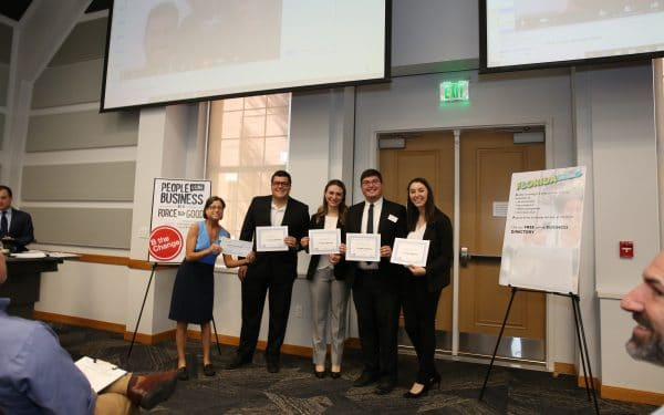 UF Business for Good Lab: Sustainable Business Consulting for B Corp certification with Kristin Joys presenting award to Sustainable Breakthroughs team, founded by Gator Grad, Grant Kendzior