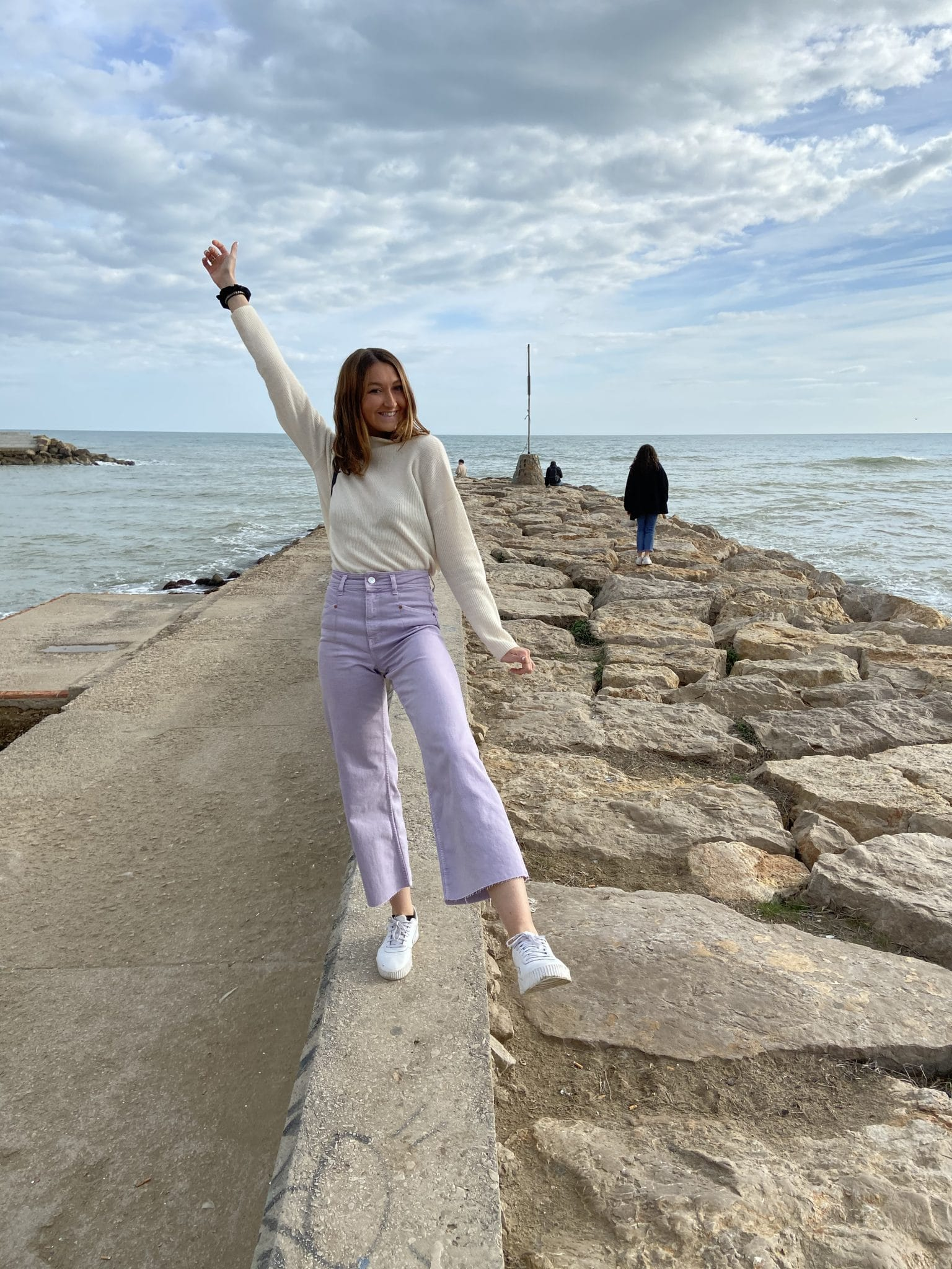 Julia Yanowitz poses for a photo on a jetty.