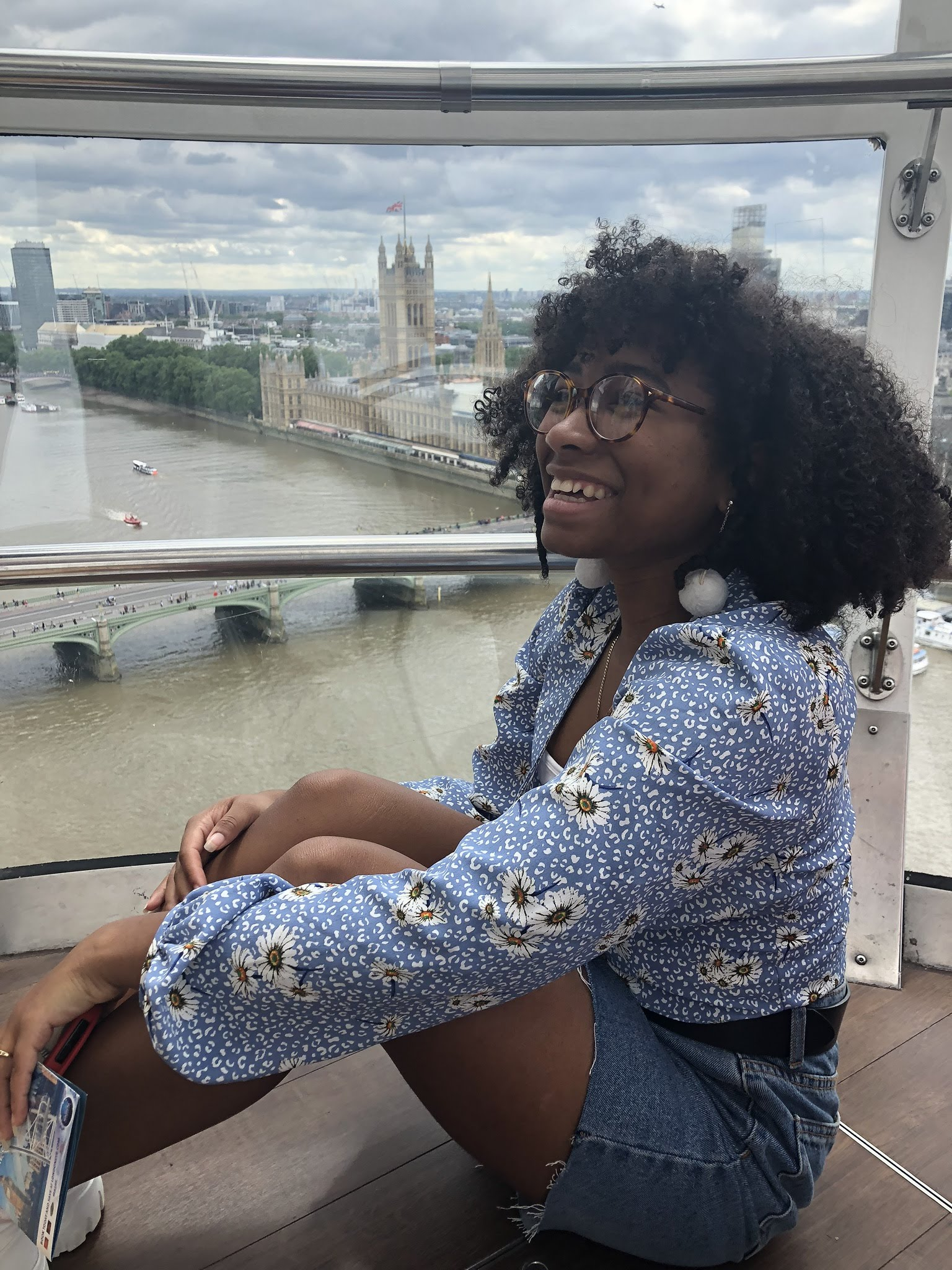 Makayla Nicholas in the London Eye with a view of Parliament and the Thames River in the background.