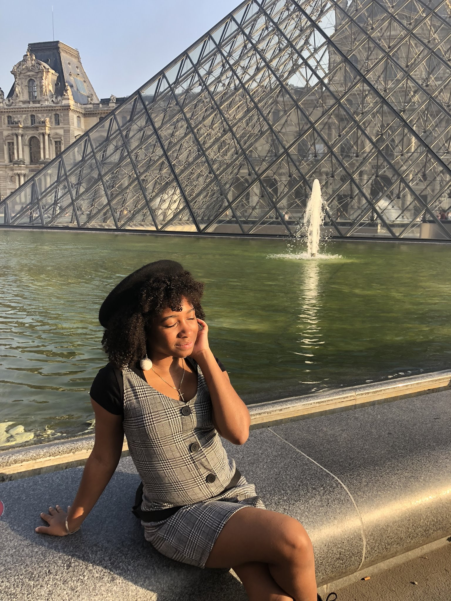 Makayla Nicholas in front of the Louvre Pyramid in Paris.