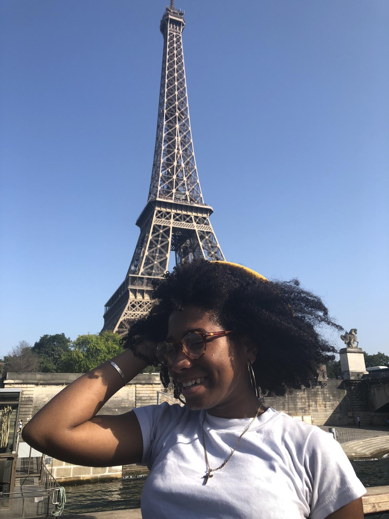 Makayla Nicholas in front go the Eiffel Tower in Paris.
