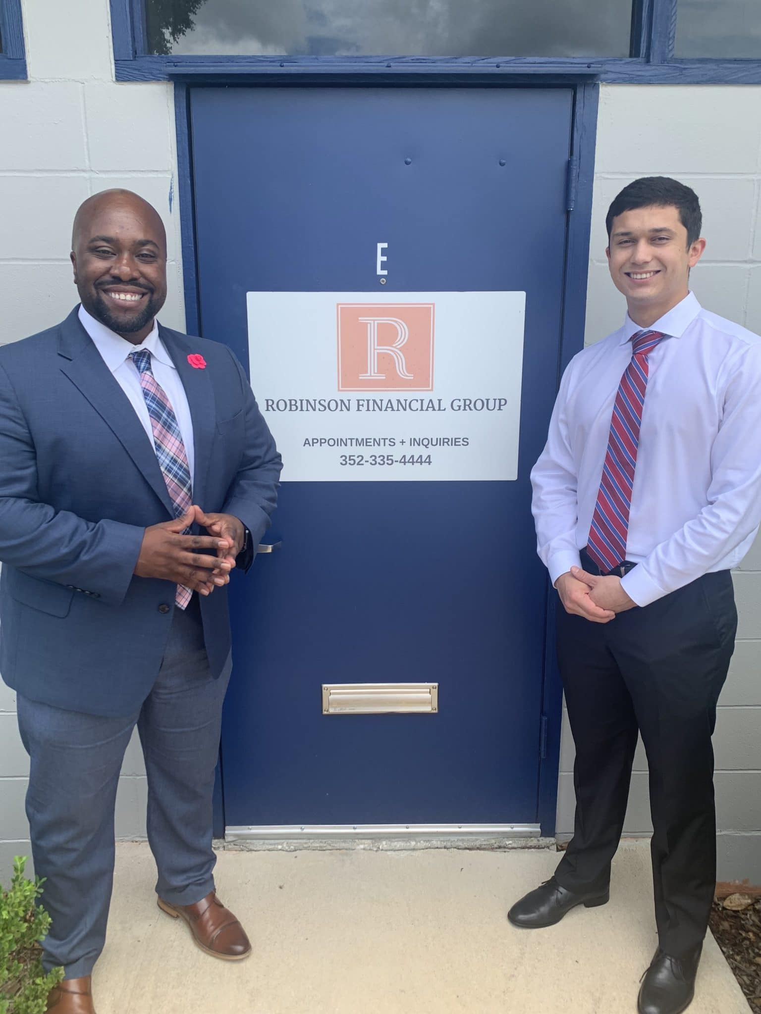 Nicholas Artires with Marcus Robinson, President of Robinson Financial Group, where Nicholas is completing his internship.