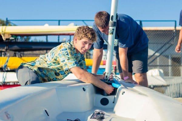 Thomas Driscoll preparing a boat to sail