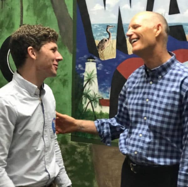 Thomas Driscoll talking with Rick Scott