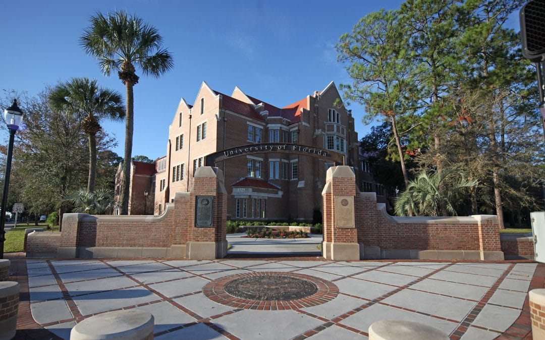 Heavener Hall in the background with the UF Archway and seal in the foreground.