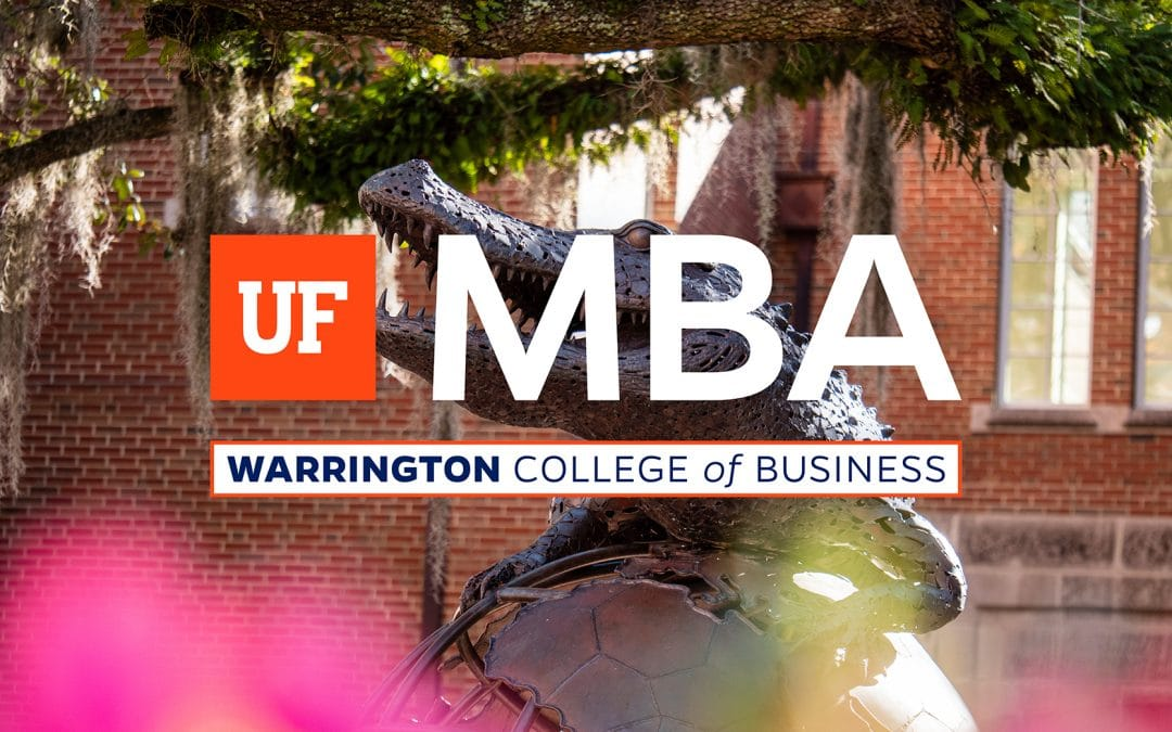 Bronze statue of an alligator on top of a globe with trees in the background and the UF MBA logo on top.