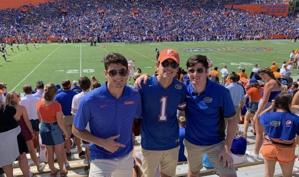 Colin Ortega with two friends at a University of Florida football game.